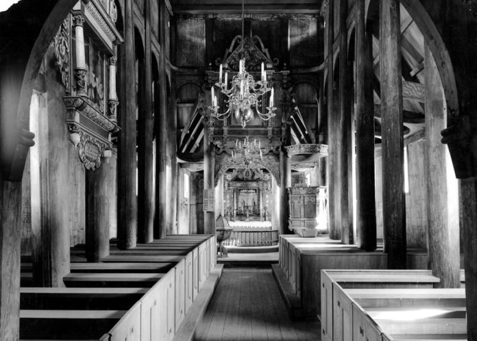 Interior from Kaupanger stave church in Sogndal, Sogn og Fjordane, Norway. Estimated built around 1137. | Photo: Unknown - kulturminnebilder.ra.no T287_01_0002 - CC BY.